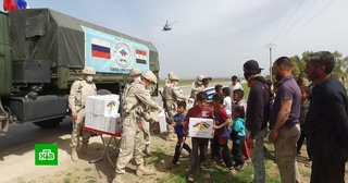 Российские военные впервые доставили гуманитарную помощь на северо-восток Сирии