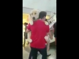 This doggo is afraid of escalators so his owner has to carry him