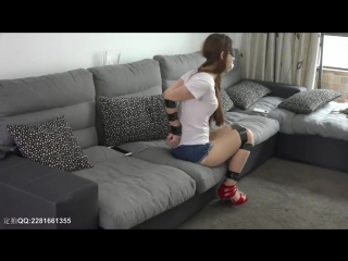 Blindfolded and gagged Chinese girl struggling.
