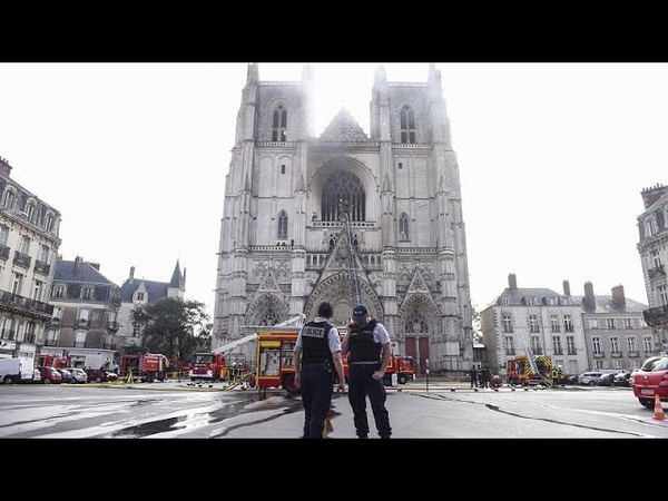 Firefighters tend to Nantes Cathedral after fire causes damage